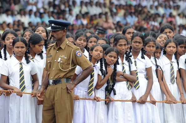 Sri Lankan school girls look on during t